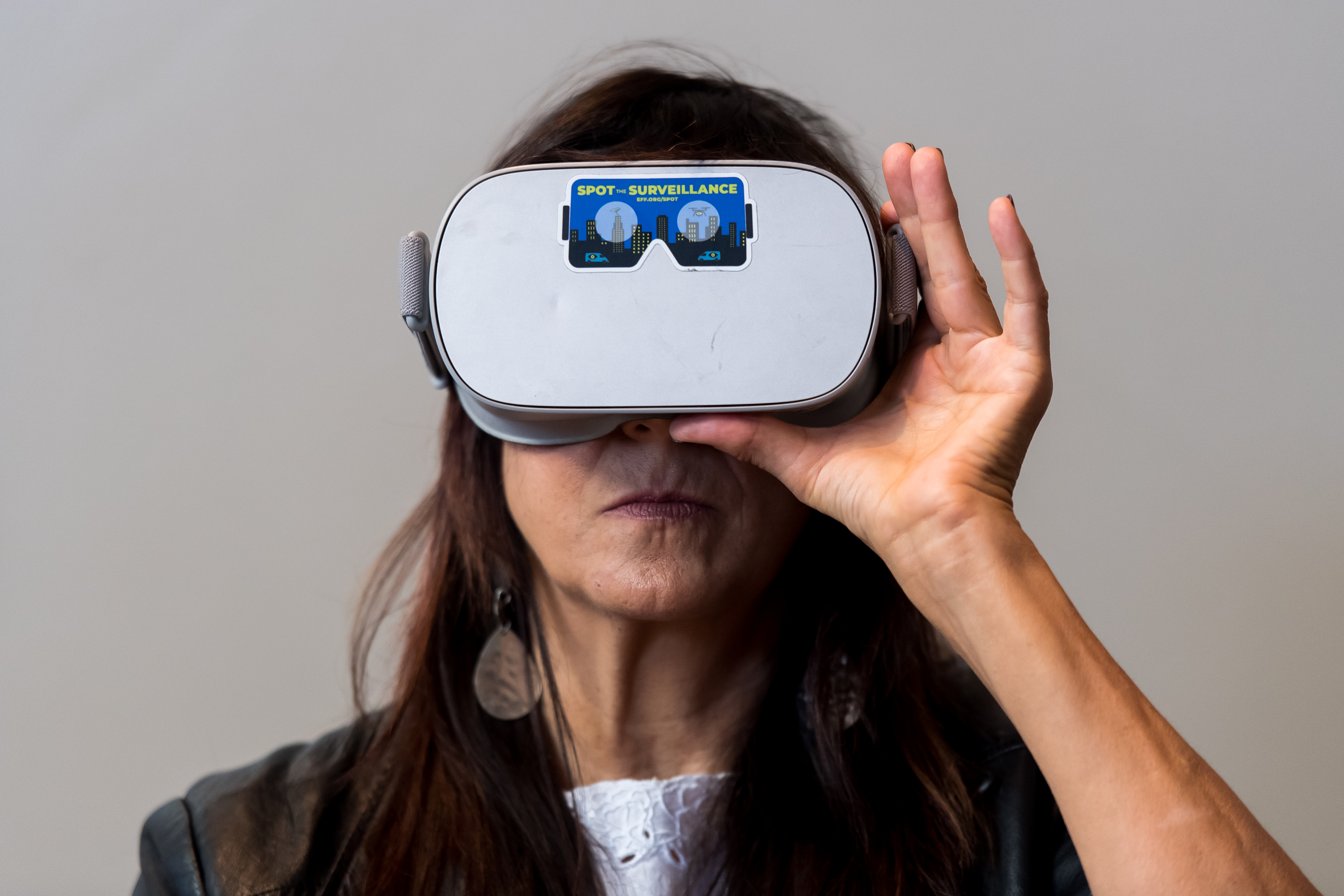 An attendee at the Journalism 360 Immersive Storytelling Festival is experiencing Electronic Frontier Foundation's Spot the Surveillance project through a virtual reality headset.